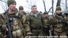 DONETSK, UKRAINE. JANUARY 22, 2015. Alexander Zakharchenko, leader of the Donetsk People's Republic (C) attends a ceremony at Donetsk Airport where the bodies of Ukrainian government servicemen were handed over to Kiev's representatives. The airport has come under control of the Donetsk Republic's forces a couple of days earlier. Mikhail Sokolov/TASS
