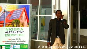 Larry Edeh Organizer of the conference on renewable energy in Abuja talking to a mobile outside the venue