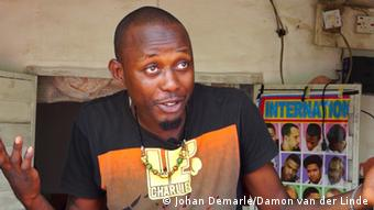 Joseph Agesoji a barbershop owner in Abuja
