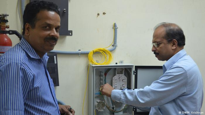 Kerala officials in a panchayat, or local village body, examine the optical fiber that has been installed