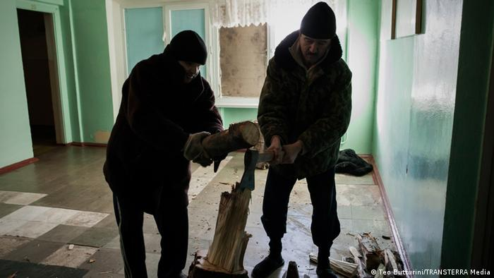 Patients cut wood inside the hospital