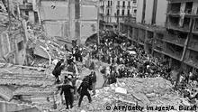 Buenos Aires, ARGENTINA: (FILE) Firemen and policemen search for wounded people after a bomb exploded at the Argentinian Israelite Mutual Association (AMIA) in Buenos Aires, 18 July 1994. Prosecutors formally charged Iran and the Shiite militia Hezbollah 25 October 2006 in the 1994 bombing of the Jewish charities office AMIA, which killed 85 people and injured 300. Prosecutors called for the arrest of top Iranian authorities at the time, including then-president Akbar Hashemi Rafsanjani . AFP PHOTO/Ali BURAFI (Photo credit should read ALI BURAFI/AFP/Getty Images)