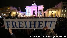 A banner reading 'Freedom' is seen during a Muslim community tolerance rally on January 13, 2015 in front of Brandenburg Gate in Berlin. Chancellor Angela Merkel and most of her cabinet are present at a Muslim community rally to promote tolerance, condemn the jihadist attacks in Paris against the Charlie Hebdo and send a rebuke to a growing German anti-Islamic 'Patriotic Europeans Against the Islamisation of the Occident' (PEGIDA) movement. AFP PHOTO / DPA / KAY NIETFELD +++GERMANY OUT (Photo credit should read KAY NIETFELD/AFP/Getty Images)