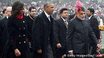 Indian Prime Minister Narendra Modi (R) escorts US President Barack Obama (C) and First Lady Michelle Obama (L) as they arrive to attend India's Republic Day Parade in New Delhi on January 26, 2015 (Photo: SAUL LOEB/AFP/Getty Images)