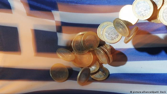 Greek flag, with euro coins