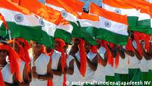 epa04585377 Indian school childrens holds Indian tri colour flag during a curltural event on Republic Day celebrations in Bangalore, India 26 January 2015. The Republic Day of India marks the adoption of the constitution of India on 26 January 1950 and US President Barack Obama will be the chief guest during India's Republic Day parade in New Delhi. EPA/JAGADEESH NV