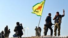 epa04586503 Members of the Syrian Kurdish People's Defence Units (YPG) celebrate their victory in Kobane, Syria, 26 January 2015. According to reports Kurdish fighters claim to have pushed militants from the group calling themselves Islamic State (IS) out of the whole of Kobane following four months of fighting, supported by airstrikes carried out by an international anti-IS coalition, though a number of the town's surrounding villages, close to the Syrian-Turkish border, remain in the hands of IS. EPA/STR +++(c) dpa - Bildfunk+++ pixel