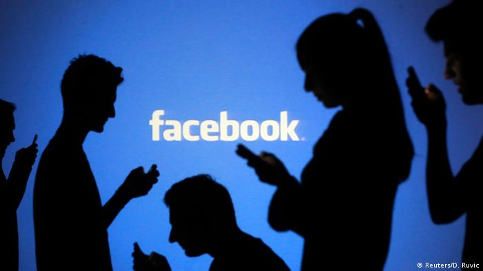 Smartphone users against a blue backdrop reading Facebook