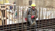 Gastarbeiter aus Tadjikistan an einer Baustelle in Moskau