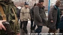DONETSK, UKRAINE. JANUARY 22, 2015. Ukrainian government servicemen taken prisoners at the Donetsk Airport are convoyed in Donetsk streets to show them destructions made by their army. Mikhail Sokolov/TASS