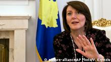 In this photo taken on Thursday, Oct. 16, 2014, Kosovo President Atifete Jahjaga gestures during an interview with The Associated Press in Kosovo's capital Pristina. Jahjaga welcomed the return of Erion Zena, an 8-year-old boy who was taken to Syria by his jihadi father, and pledged the Ballkan country will not tolerate religious extremists. (AP Photo/Visar Kryeziu)