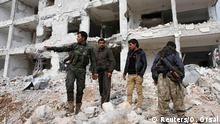 Fighters of the Kurdish People's Protection Units (YPG) stand on the debris of a damaged building in the northern Syrian town of Kobani January 28, 2015. Kurdish forces battled Islamic State fighters outside Kobani on Tuesday, a monitoring group said, a day after Kurds said they had taken full control of the northern Syrian town following a four-month battle. Known as Ayn al-Arab in Arabic, the mainly Kurdish town close to the Turkish border has become a focal point in the international fight against Islamic State, an al Qaeda offshoot that has spread across Syria and Iraq. REUTERS/Osman Orsal (SYRIA - Tags: POLITICS TPX IMAGES OF THE DAY CONFLICT)