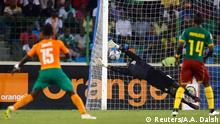 Max Gradel of Ivory Coast (L) scores a goal against Cameroon during their Group D soccer match of the 2015 African Cup of Nations in Malabo January 28, 2015. REUTERS/Amr Abdallah Dalsh (EQUATORIAL GUINEA - Tags: SPORT SOCCER)