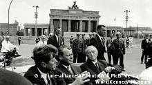 FILE - In this photo released by the Kennedy Museum, President John F. Kennedy, left, Willy Brandt, center, then mayor of West Berlin, and West German Chancellor Konrad Adenauer, right, ride in a car at the Brandenburg Gate June 26, 1963. Berlin is celebrating Wednesday, June 26, 2013, the 50th anniversary of President John F. Kennedy's famed Ich bin ein Berliner speech — a pledge of support to the divided city on the Cold War's front line that still resonates in a much-changed world. (AP Photo/Will McBride-Camera Work, Kennedy Museum, File) MANDATORY CREDIT