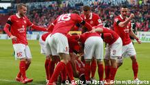 MAINZ, GERMANY - JANUARY 31: Yunus Malli #11 celebrates his team's first goal with team mates during the Bundesliga match between 1. FSV Mainz 05 and SC Paderborn at Coface Arena on January 31, 2015 in Mainz, Germany. (Photo by Alex Grimm/Bongarts/Getty Images)