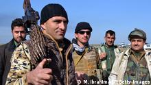 Kurdish Peshmerga fighters gather during an operation to retake Khubbaz oil field from IS group on January 31, 2015 near the northern Iraqi city of Kirkuk. 'Peshmerga forces and police cleared the Khubbaz oil field a little while ago and were able to enter it after surrounding it for hours,' police Brigadier General Sarhad Qader said of the fighting, adding that they also retook eight villages. AFP PHOTO / MARWAN IBRAHIM (Photo credit should read MARWAN IBRAHIM/AFP/Getty Images)