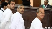 epa04599057 (FILE) A file photo dated 31 March 2014 shows Australian journalist Peter Greste (R), Canadian-Egyptian journalist Mohammed Fahmy (C) and journalist Baher Mahmoud (L) standing in front of the judge's bench during their trial for allegedly supporting a terrorist group and spreading false information, in Cairo, Egypt. According to local reports Peter Greste will be deported to Australia 01 February 2015 after serving 400 days in jail, as yet there is no news about his colleagues from al-Jazeera Mohammad Fahmy or Baher Mahmoud. EPA/KHALED ELFIQI +++(c) dpa - Bildfunk+++