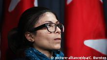 epa04593787 Ensaf Haidar, wife of Saudia Arabian blogger Raif Badawi listens in at a news conference in Ottawa, Canada on 29 January 2015, calling for Canadian Prime Minister Harper to intervene in the flogging her husband has been sentenced to in Saudi Arabia. Badawi was sentenced to 1,000 lashes and 10 years in prison for advocating free speech on his Saudi Arabian Liberals blog and has already endured 50 of the 1,000 lashes. EPA/COLE BURSTON +++(c) dpa - Bildfunk+++