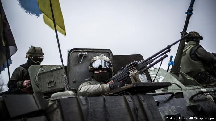 Ukrainian soldiers in an armored vehicle near the Donetsk region