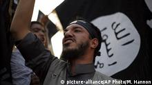 FILE - In this Sept. 14, 2012 file photo, a Libyan follower of Ansar al-Shariah Brigades chants anti-U.S. slogans during a protest in front of the Tibesti Hotel, in Benghazi, Libya. On Friday, Oct. 31, 2014, bearded militants gathered at a stage strung with colorful lights in Darna, a Mediterranean coastal city long notorious as Libya's center for jihadi radicals. With a roaring chant, they pledged their allegiance to the leader of the Islamic State group. Many of Darna's militants joined, though some didn't. Part of Ansar al-Shariah, one of the country's most powerful Islamic factions, joined while another part rejected it. (AP Photo/Mohammad Hannon, File)