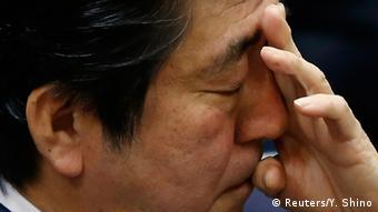 Japan's Prime Minister Shinzo Abe scratches his face during an upper house committee session at the parliament in Tokyo February 2, 2015 (Photo: REUTERS/Yuya Shino))