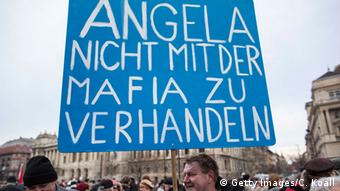 Sign supporting Angela Merkel. (Photo: Carsten Koall/Getty Images)