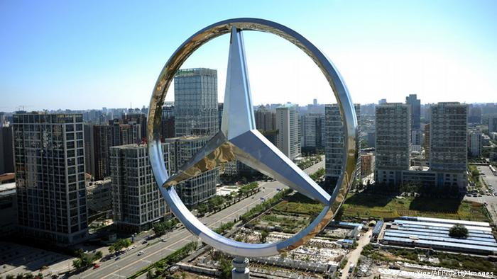 The giant logo of German vehicle maker Daimler's Mercedes-Benz sits on the top of its head office building in Beijing on October 11, 2010