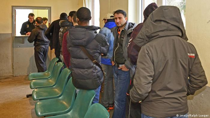 Immigrants in a waiting room