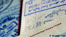 Stamps in a German passport (imago/J. Tack)