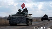 Members of the armed forces of the separatist self-proclaimed Donetsk People's Republic gather at a checkpoint in Vuhlehirsk, Donetsk region, February 4, 2015. REUTERS/Maxim Shemetov (UKRAINE - Tags: CONFLICT CIVIL UNREST MILITARY)