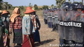 Farmers confront riot police at the site of the Letpadaung copper-mine near Monywa in northwestern Myanmar Monday, Dec. 22, 2014 (AP Photo)