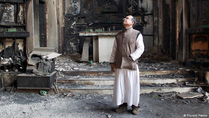 A Christian priest in a burned out church in Delhi (Photo: Florent Martin)