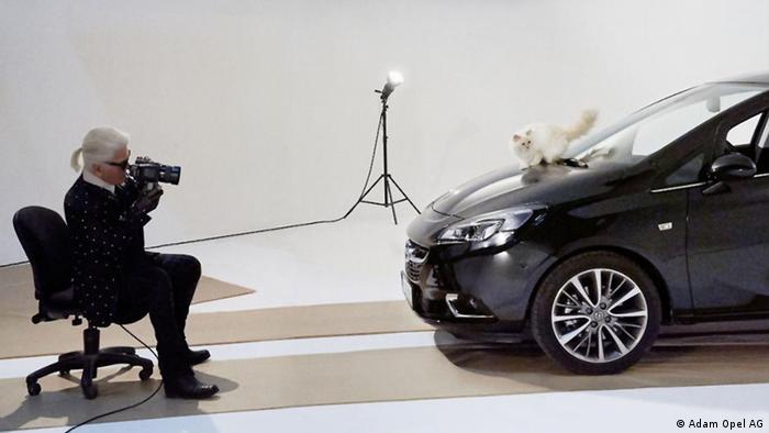 Karl Lagerfeld taking a picture of cat on car (Adam Opel AG)