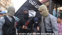 September 20, 2013 - Aleppo, Syria - Masked Al Qaeda fighters with young boy from the Islamic State of Iraq and the Levant Syria with AK-47 machine gun. A Syrian town on the border with Turkey has been captured from the Free Syrian Army, not by forces loyal to the regime of Syrian President, but by Islamist rebels backed by al-Qaeda. The violent takeover of the town has laid bare the deep rifts that plague the movement to oust Assad