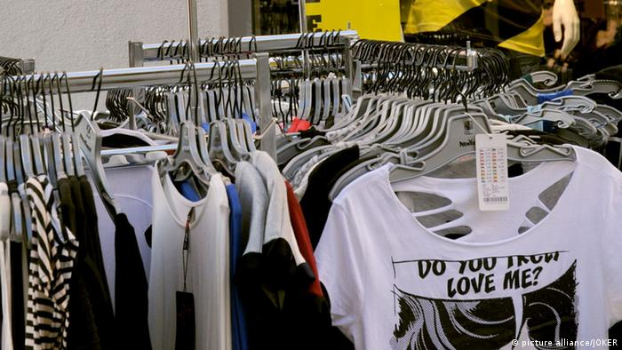 Cheap T-shirts in a textile store in Memmingen, Germany