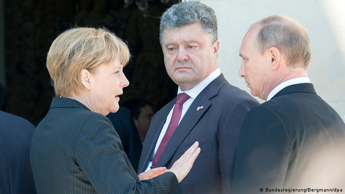 Анґела Меркель, Петро Порошенко та Володимир Путін, червень 2014 року