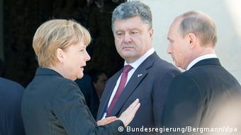 Merkel mit Poroschenko und Putin Foto: Bundesregierung/Bergmann/dpa