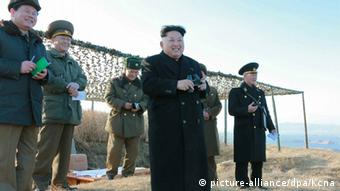 An undated handout picture released by the official North Korean Central News Agency (KCNA) on 07 February 2015 shows North Korean leader Kim Jong-un (4-L) watching the test-firing of a new anti-ship rocket at an undisclosed location. North Korean state media on 07 February reported that the new anti-ship missile will be deployed 'before long' at its naval units (Photo: EPA/KCNA)