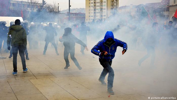 Kosovo police officers fire tear gas during clashes at a demonstration in Pristina, Kosovo, 27 January 2015 (photo: EPA/STRINGER)