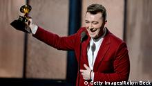 Grammy winner for Best Pop Vocal Album Sam Smith talks to the audience on stage at the 57th Annual Grammy Awards in Los Angeles February 8, 2015. AFP PHOTO/ROBYN BECK (Photo credit should read ROBYN BECK/AFP/Getty Images)