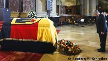 11.02.2015 * German President Joachim Gauck pays tribute in front of the coffin of former German President Richard von Weizsaecker during a state funeral service at the Berlin Cathedral in Berlin February 11, 2015. Former president Richard von Weizsaecker, who challenged German attitudes about the Holocaust by arguing that the country had been liberated by the Nazi defeat in 1945, died on Saturday at the age of 94, the current president's office said. REUTERS/Markus Schreiber/Pool (GERMANY - Tags: OBITUARY SOCIETY POLITICS)