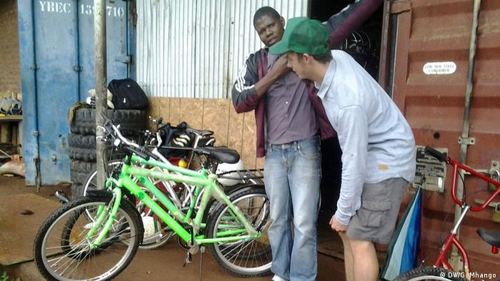 Volunteer Maxim Goecke and an Africycle colleague next to a bicycle