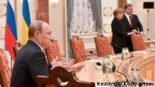 11.02.2015 Russia's President Vladimir Putin (L) gestures as he takes part in peace talks on resolving the Ukrainian crisis, with Ukraine's President Petro Poroshenko (R) and Germany's Chancellor Angela Merkel in Minsk, February 11, 2015. The four leaders meeting on Wednesday for peace talks in Belarus on the Ukraine crisis are planning to sign a joint declaration supporting Ukraine's territorial integrity and sovereignty, a Ukrainian delegation source said. REUTERS/Kirill Kudryavtsev/Pool (BELARUS - Tags: POLITICS CIVIL UNREST CONFLICT MILITARY)