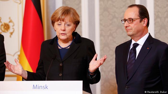 Канцлер ФРГ Ангела Меркель на совместной с президентом Франции Франсуа Олландом пресс-конференции по итогам саммита в Минске по урегулированию кризиса на Украине