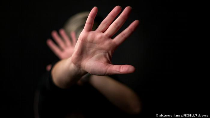 An illustration on the theme of domestic violence showing a woman's hands