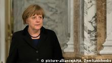 12.02.2015 German Chancellor Angela Merkel walks to continue with the peace talks in Minsk, Belarus, Thursday, Feb. 12, 2015. French President Francois Hollande says he and German Chancellor Angela Merkel are committed to helping verify the cease-fire process in Ukraine, along with the Russian and Ukrainian leaders. Leaders of Russia, Ukraine, France and Germany on Thursday emerged from marathon 16-hour talks to announce a comprehensive peace deal for eastern Ukraine, but questions remained whether Ukraine and the pro-Russian rebels have agreed on all of its terms. (AP Photo/Alexander Zemlianichenko)