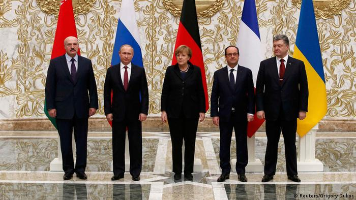 The five participants of Ukraine conflict peace talks in Minsk stand shoulder-to-shoulder