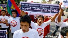 11.02.2015** A man holds up a banner during a protest to demand the revocation of the right of holders of temporary identification cards, known as white cards, to vote, in Yangon February 11, 2015. Roughly two-thirds of the white-card holders are Rohingya Muslims, who are widely resented in the Buddhist majority nation, where many people consider them illegal immigrants from Bangladesh. REUTERS/Soe Zeya Tun (MYANMAR - Tags: POLITICS CIVIL UNREST SOCIETY ELECTIONS)