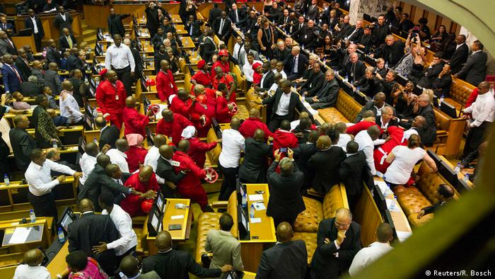 Members of Julius Malema's party clash with security officials after being ordered out of the chamber during President Jacob Zuma's annual address.