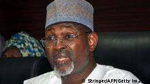 7. Feb. 2015 Chairman of the Independent National Electoral Commission (INEC) Attahiru Jega speaks on February 7, 2015 in Abuja as Nigeria has postponed its presidential election on security grounds as the Boko Haram conflict intensifies, handing a potential lifeline to the ruling party as it battles a tough challenge from the opposition. The six-week delay was announced on February 7 after security chiefs said the military needed more time to secure areas under the control of Boko Haram, the Islamist extremists who have seized swathes of northeastern Nigeria. AFP PHOTO / STRINGER (Photo credit should read STRINGER/AFP/Getty Images)